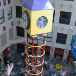 Ornamental metal Aluminum clock tower supports clock box in Childrens hosptial cafeteria