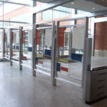 Aluminum security divider with colored glass supported by stainless rods