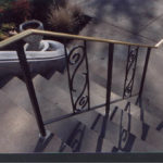 Black painted steel railing with bronze top rail
