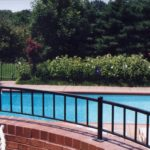 Black powder coated steel deck rail at pool 2