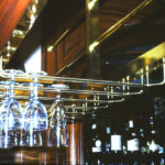 Bronze glass rack at above a bar