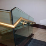 Bronze railings and brackets on glass rail at Bryan Cave law firm