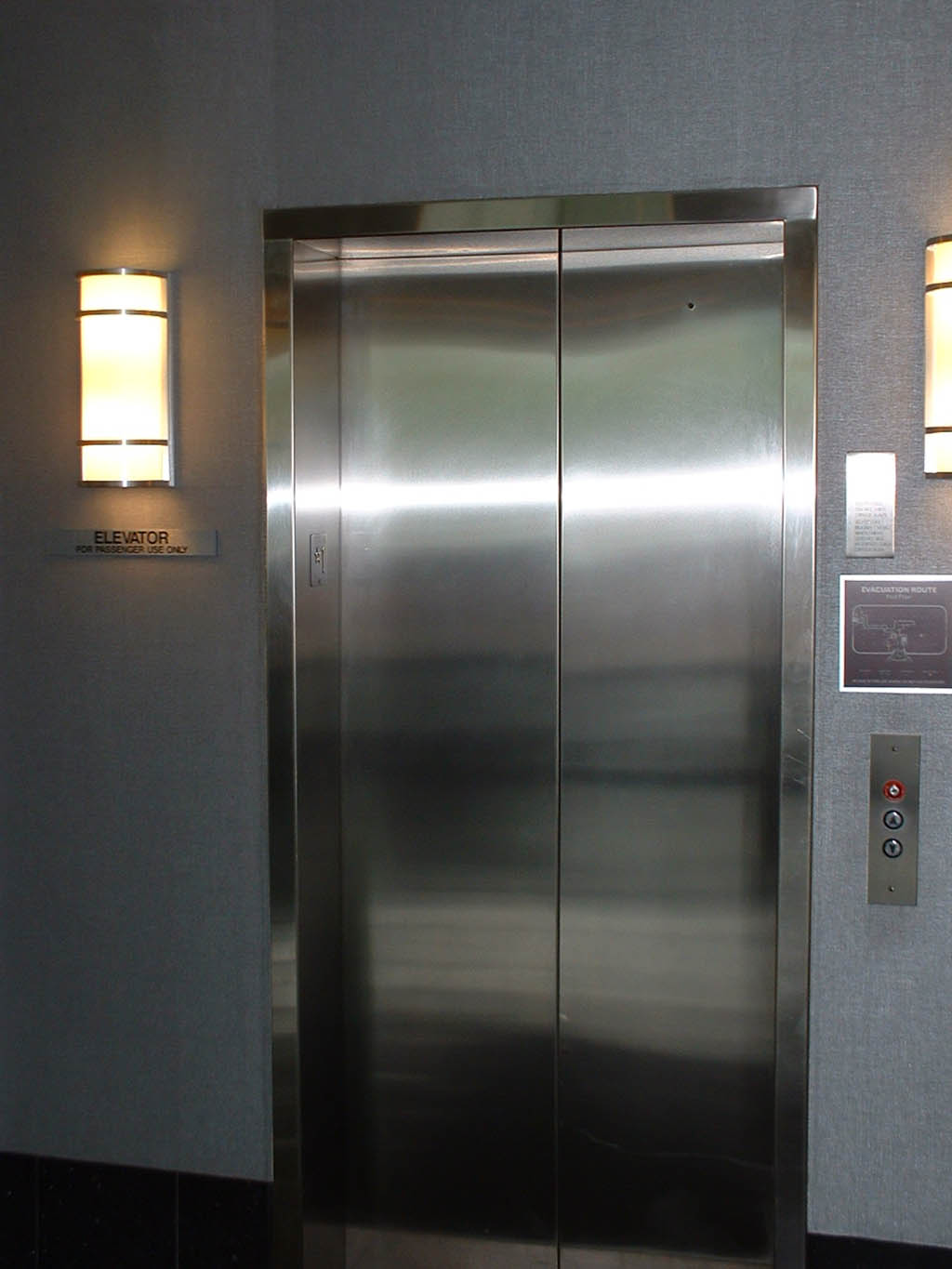 Brush Stainless Header And Jamb Cladding At Elevator In