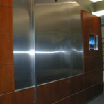 Decorative stainless wall panel and monitor frame