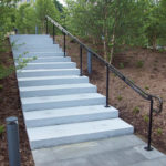 Freestanding bronze railings with an antiqued finish at City Garden in downtown St Louis