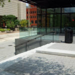 Glass and bronze railings with an antiqued finish at City Garden in downtown St Louis