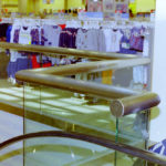 Glass and stainless steel railing and shoe cladding in a mall 5