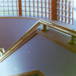 Mirror finish bronze handrails in a residence 3