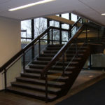Painted steel and glass railings at Emerson Electric