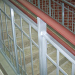Painted steel guardrails with wood cap and grabrail and stainless steel cladding on the stringer 2
