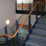 Painted steel guards, wood railing on glass guardrail at Wash Univ social science building