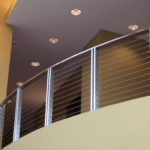 Radiused brushed stainless steel balcony railing with stainless cable infill 3
