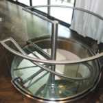 Stainless and glass spiral stair in residence 13