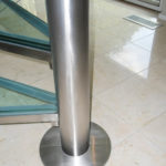 Stainless steel and glass spiral stair in residence 15