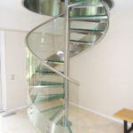 Stainless steel and glass spiral stair in residence 17