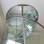 Stainless steel and glass spiral stair in residence 20