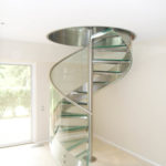Stainless steel and glass spiral stair in residence 4