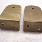 Steel brackets with antiqued bronze plating