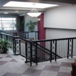 Steel railing with wood grab rails at Ofallon MO city hall