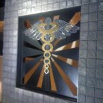 Decorative metal stainless steel and bronze caduceus symbol1