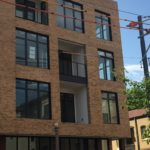 Painted Steel Balcony Rails with Stainless Cable Infill at 4101 Laclede
